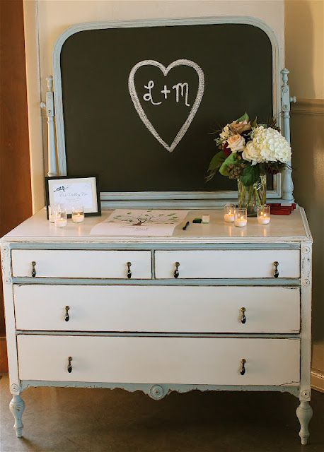 Beautifully re-styled vintage dresser... The mirror has been painted with chalkboard paint! So cute and unexpected!