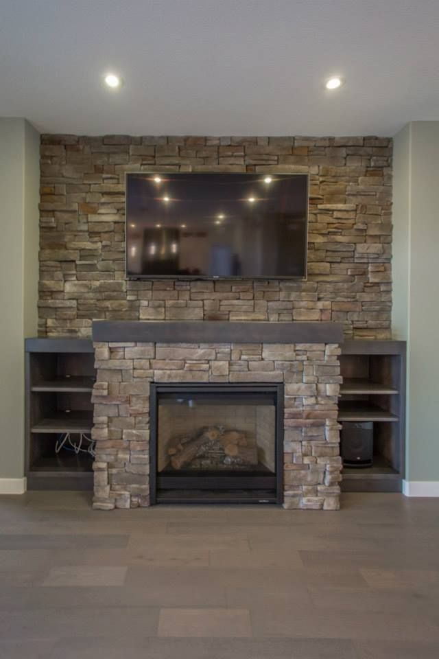 Built Out Fireplace With Stone Accent Around And Full Stone Tile Wall Behind With Half Wall Height Shelving Natural Stone Fireplaces Stone Fireplace Fireplace