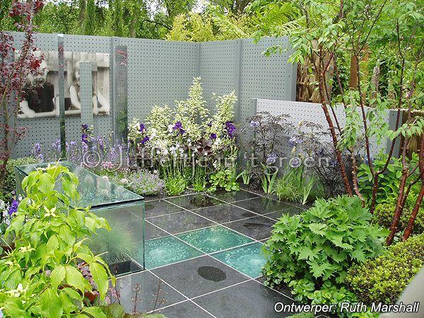 Kleine tuinen voorbeelden schaduwdoek voor de tuin for Stadstuinen voorbeelden
