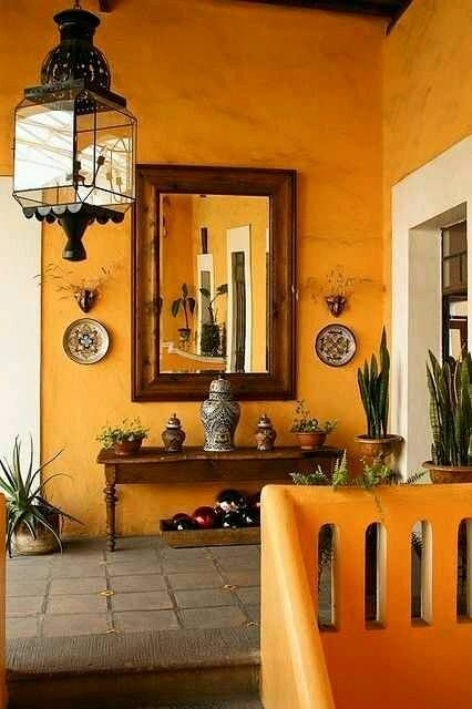 Tuscan Orange Wall- Living Room With Dark Wood Details
