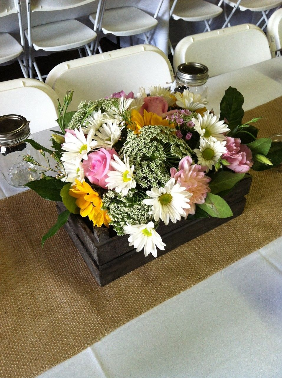 Rustic wedding centerpiece with wood crate, burlap and daisies by Fields in Bloom
