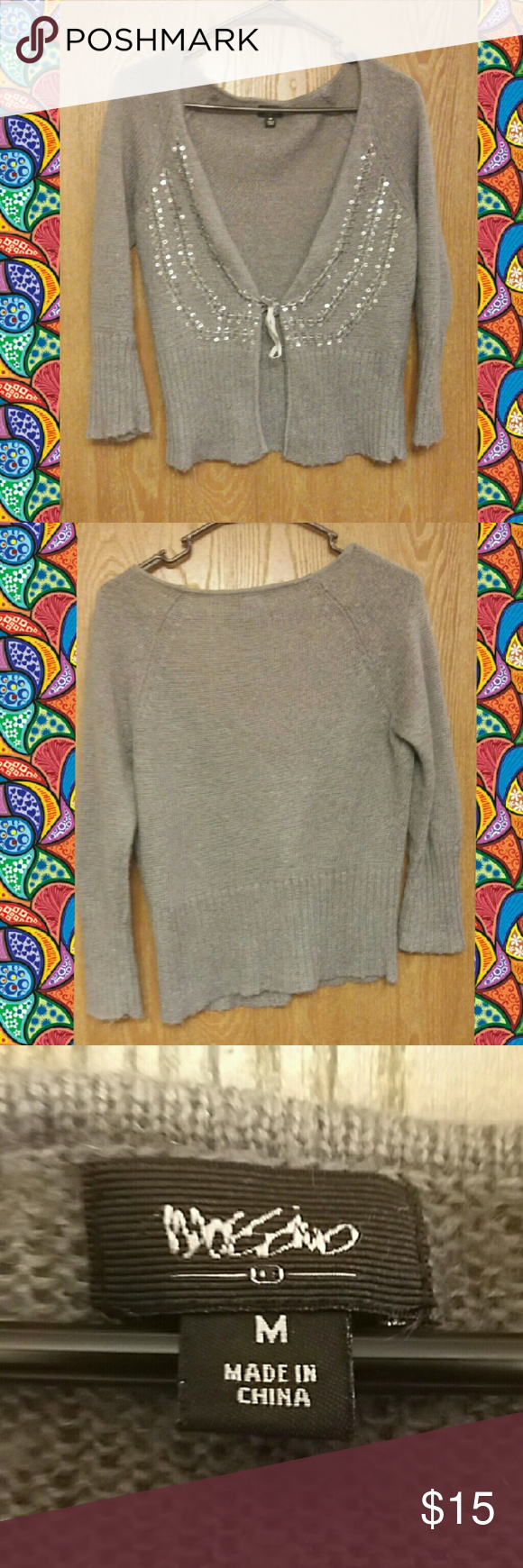 Mossimo grey sequin cardigan sweater. Used a bit but still in good condition. No rips or tears. Has a little Pilling as it's a wool cardigan whixh can be handled, but still great condition.sequins are intact. Mossimo Supply Co Sweaters Cardigans