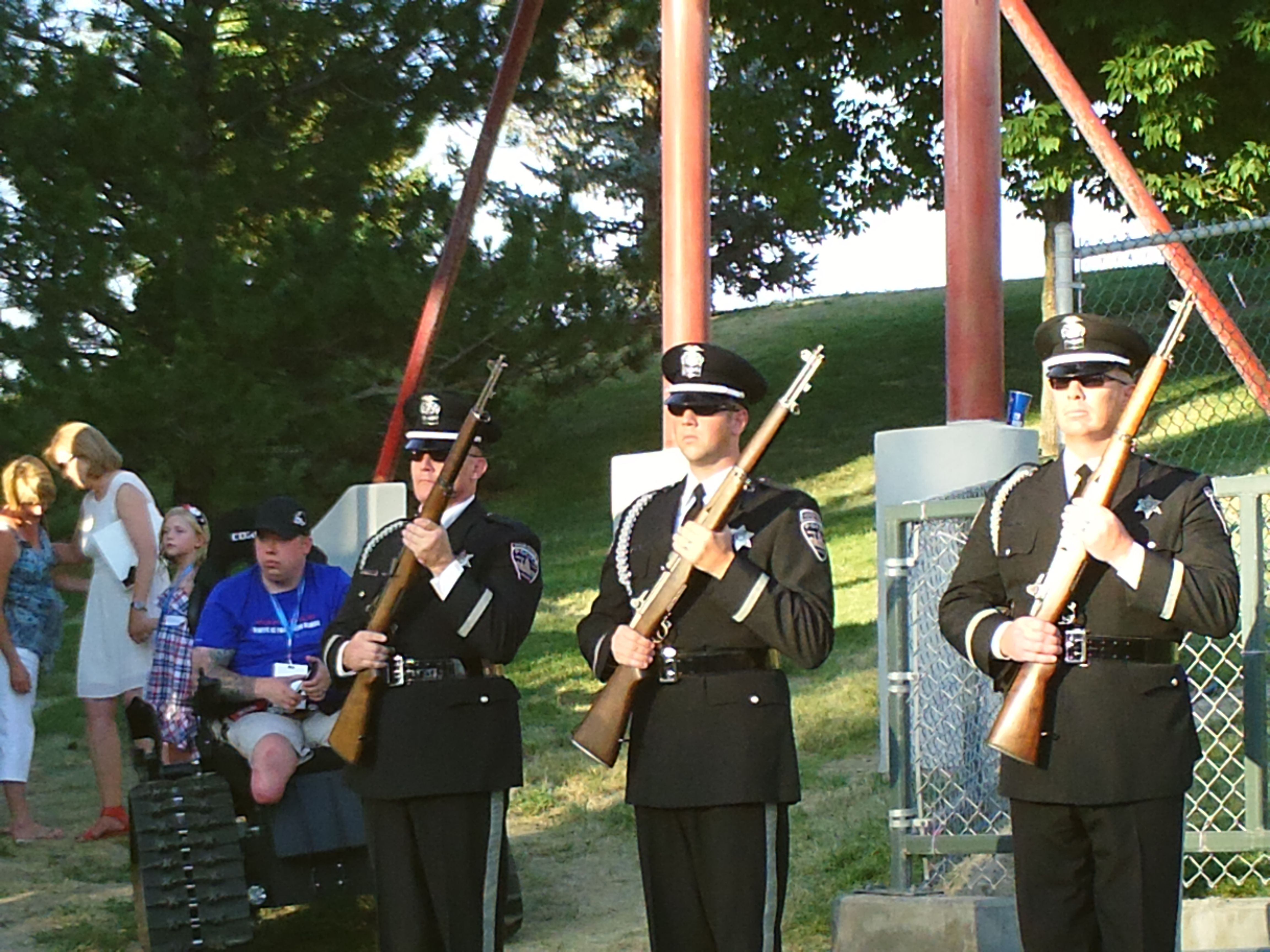 PT NAMPA IDAHO. 21 GUN SALUTE GUYS WAIT FOR THE FLAG TO COME OFF THE STAGE. JULY 2015