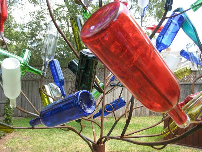 Some cities don't recycle glass, but that doesn't mean you can't reuse glass bottles for candles, hummingbird feeders or even chandeliers.