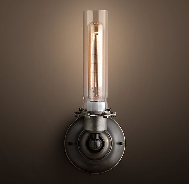 RH's Edison Glass Sconce:Fitted with a valve and a striker, a shade to protect the flame, and a cage to protect the shade, turn-of-the-century gas lamps were the forerunners of both 20th-century electrification and contemporary industrial design. Our replica guards a vintage-style filament bulb.