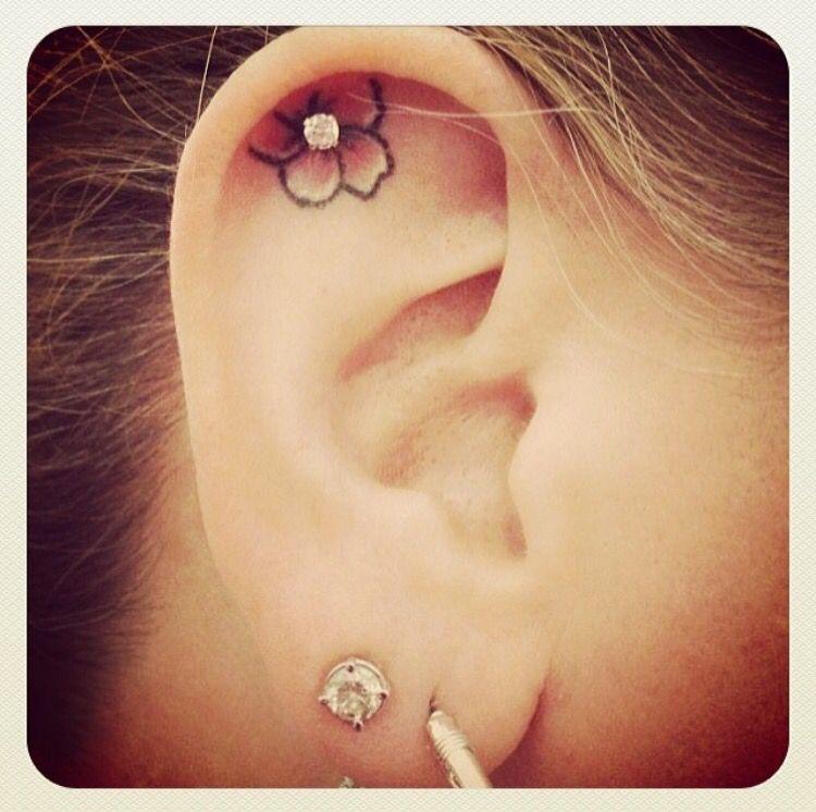 Flower tattoo earring tattoos piercings ear tattoo