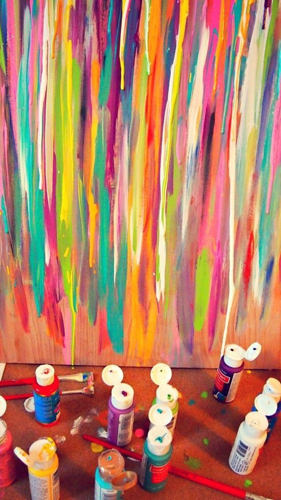 line up three canvases with the drippy paint on the wall ...