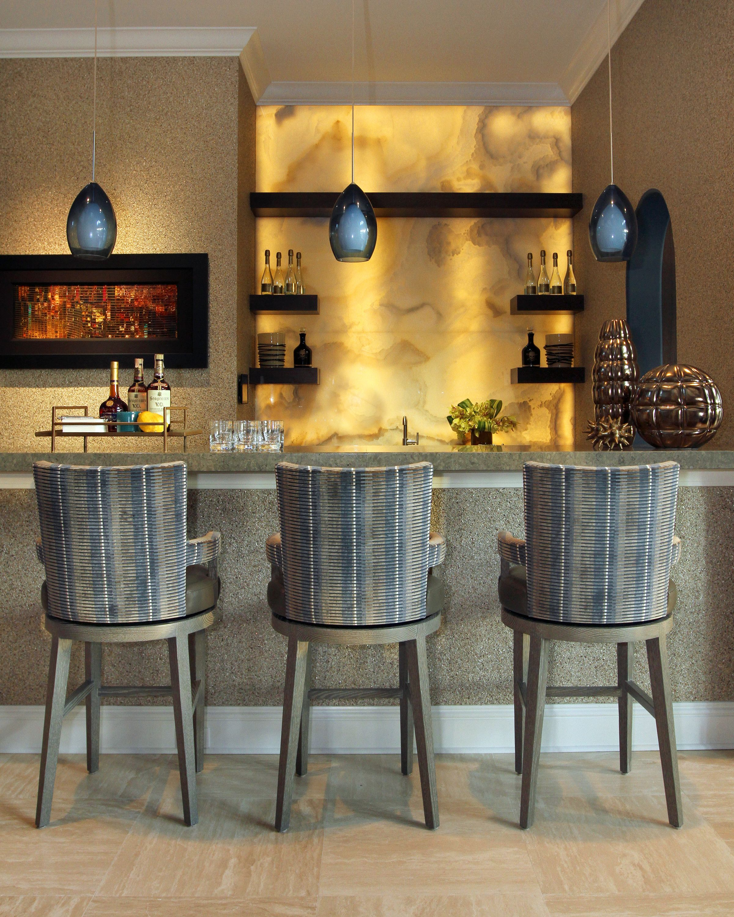 The backlit Onyx wall creates a great focal point for the bar ...