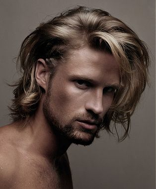A long blonde straight coloured hairstyle by John Carne
