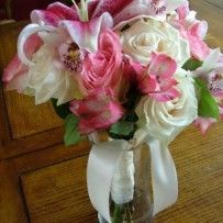 Stargazer lilies, Alstromeria, Roses, and Orchids for a wedding at the Casey House in Breckenridge, Colorado.