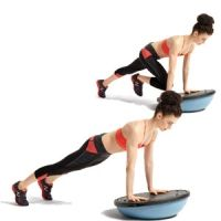 BOSU Mountain Climber  Place the balance trainer dome-side down, then get into a pushup position with your shoulders directly over your wrists. Keeping your hips in place, bend one knee toward your chest, then return to the starting position. Repeat quickly with the other knee, and continue alternating.