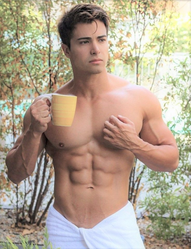 muscular latino barista drills hunk in office lunch area