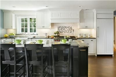 Contemporary Traditional Kitchen has sink stove and refrigerator all on same wall. relaxing