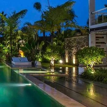 Tropical Gardens At Night Lighting Brings To Life A Daytime Garden Lights Reflection And Materials Give An Landscaping Company Tropical Landscaping Landscape