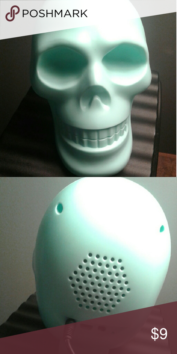Skull speaker Aqua skull speaker comes with USB cord to plug into your phone it's Bluetooth also Other Phone Cases