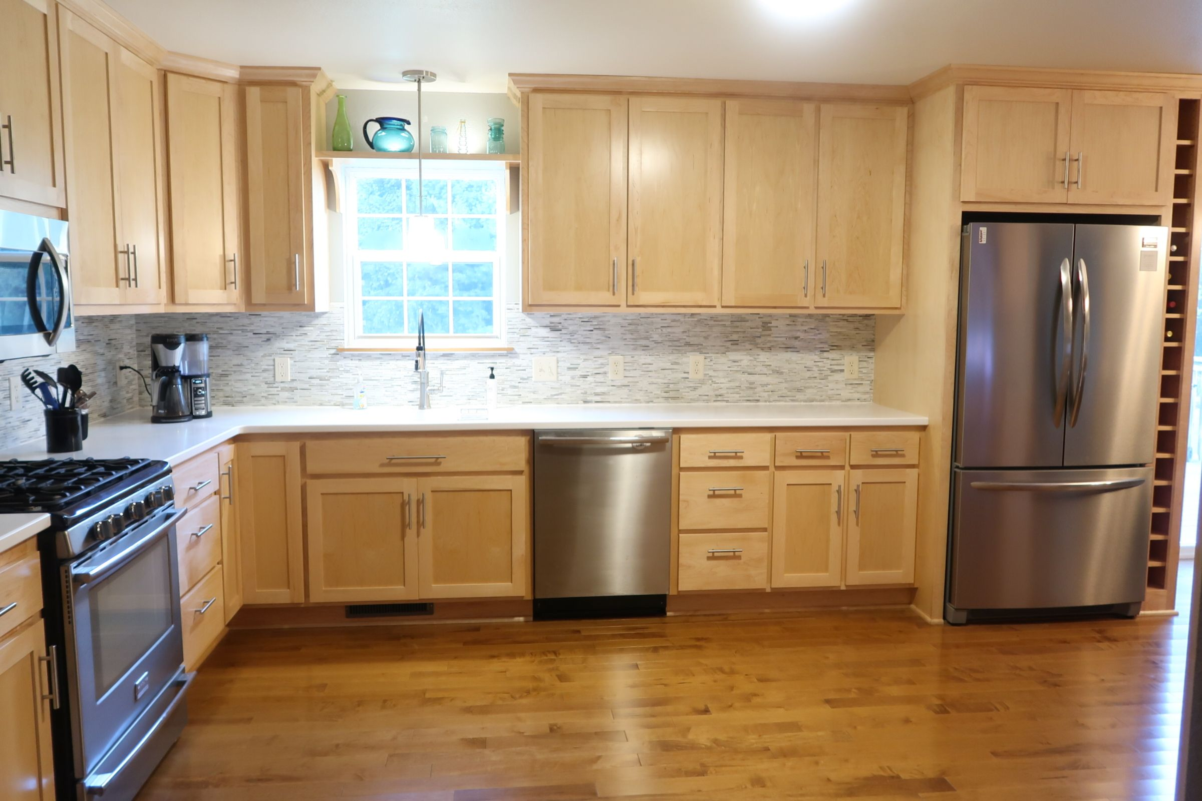 Natural Maple cabinets with maple flooring and Hi Macs ...