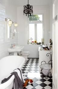 White Bathroom With Black White Tiles And Black Chandelier