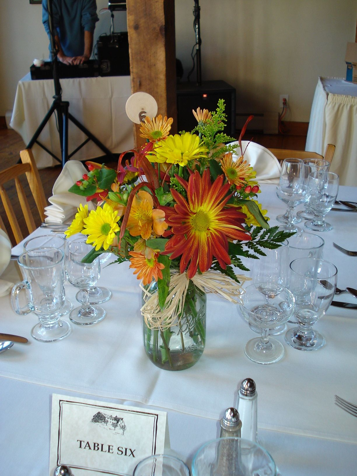 Mason jar centerpieces fall wedding oranges and yellows weddings