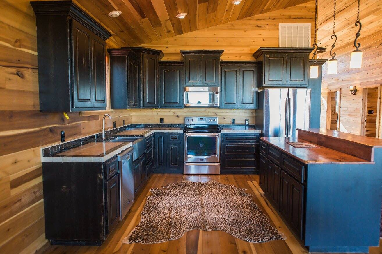 Barn Home Kitchen With Black Cabinets And Cedar Tops Www Barnsandbuildings Com Black Distressed Cabinets Rustic Barn Homes Black Kitchen Cabinets
