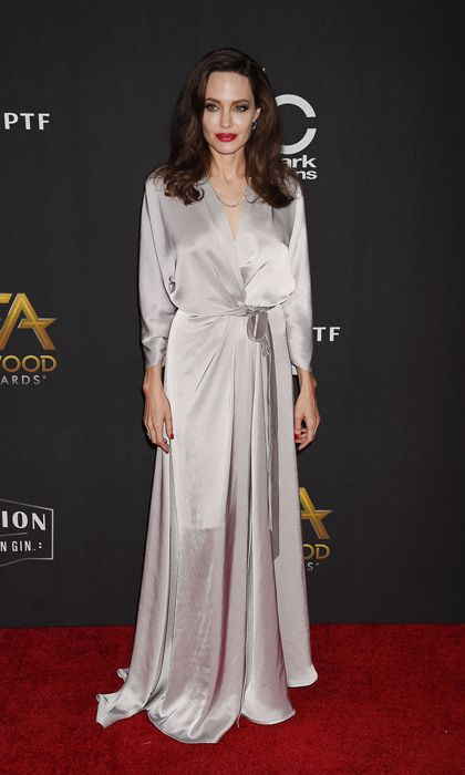 c950b53d5325 Angelina Jolie wore silver satin dress by Kate Middleton's favorite Jenny  Packham to the Hollywood Film Awards on November 5.