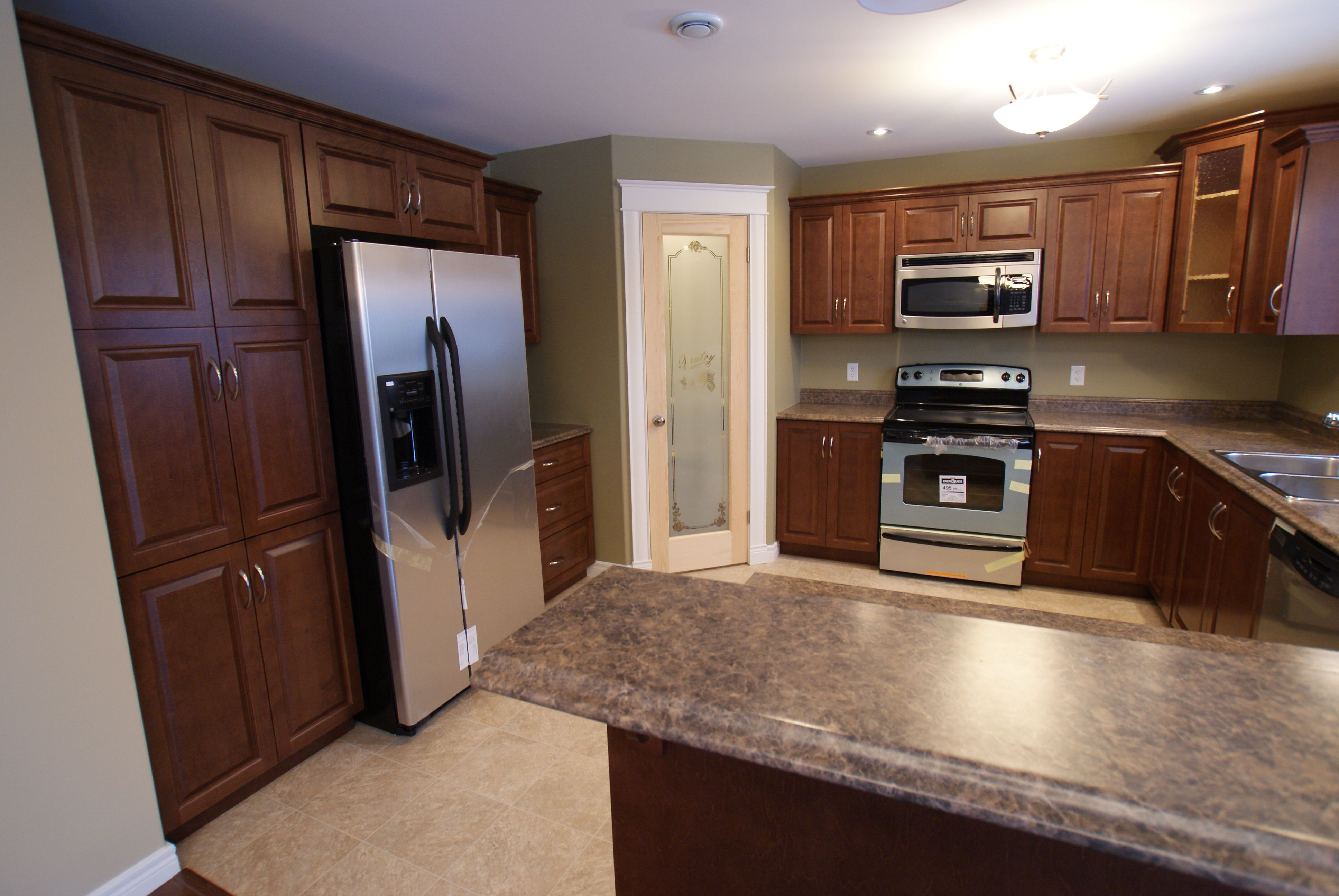 Nutmeg Cabinets And River Gemstone Countertops