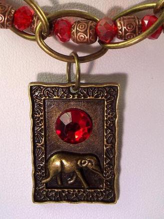 Ruby Elephant Bronze Necklace By Texas Tazmacc Insurance Auto
