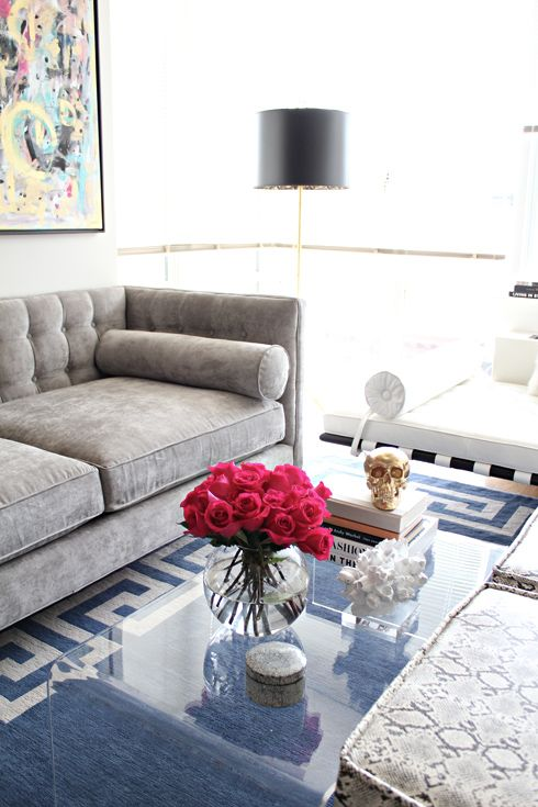 Small living room in MadeByGirl's plain new rental - love the tufted grey velvet sofa