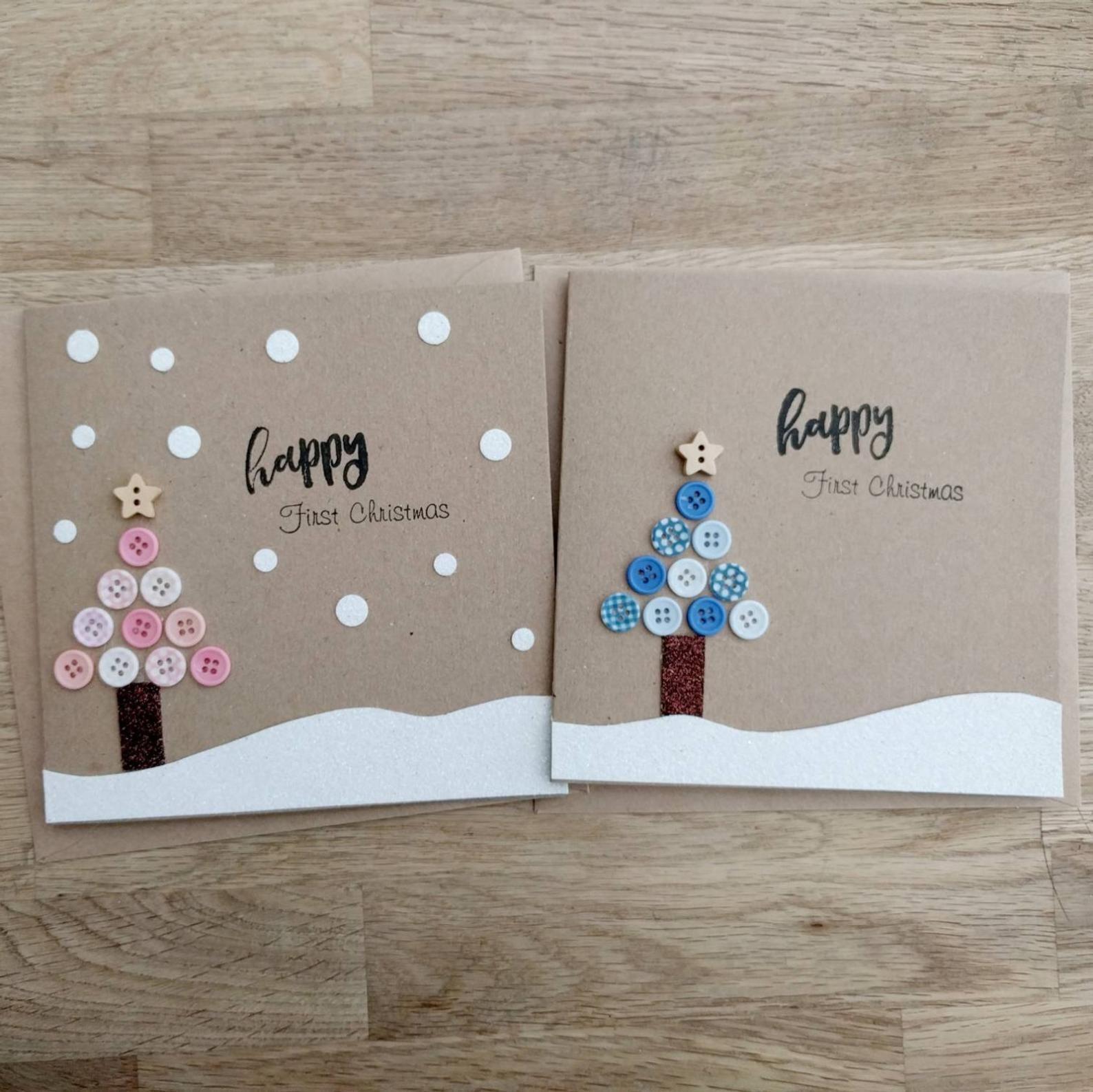 Première carte de Noël de beau bébé fait à la main en bleu ou