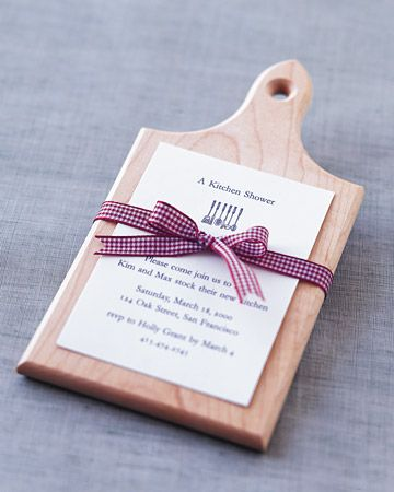 send guests invitations framed on mini cutting boards for a kitchen stocking shower - Kitchen Shower Ideas