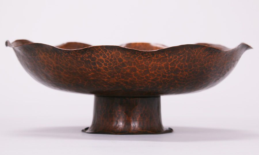 "The Metalcraft Shop hammered copper fruit bowl c1930s.  The Metalcraft Shop was located at 619 Beach St in San Francisco and a collaboration between Agatha van Erp (Dirk van Erp's daughter) and Mrs Lucille Bush to teach metal work during the Depression.  Inscribed on bottom ""The Metalcraft Shop"".  13″d x 4.5″h"