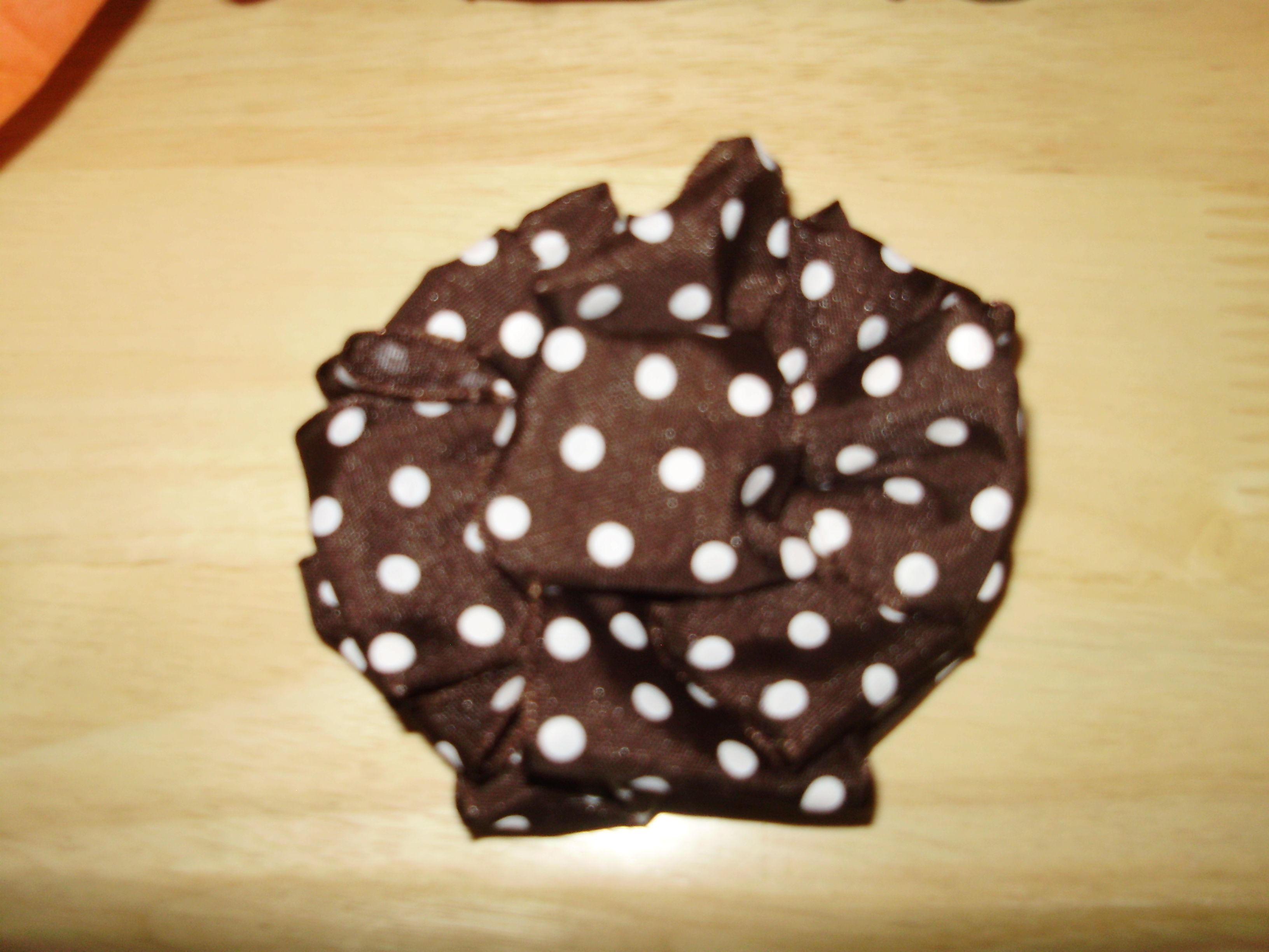 Pom Pom Bow - tutorial here: http://www.apartmenttherapy.com/wrap-it-up-how-tos-from-the-co-72066