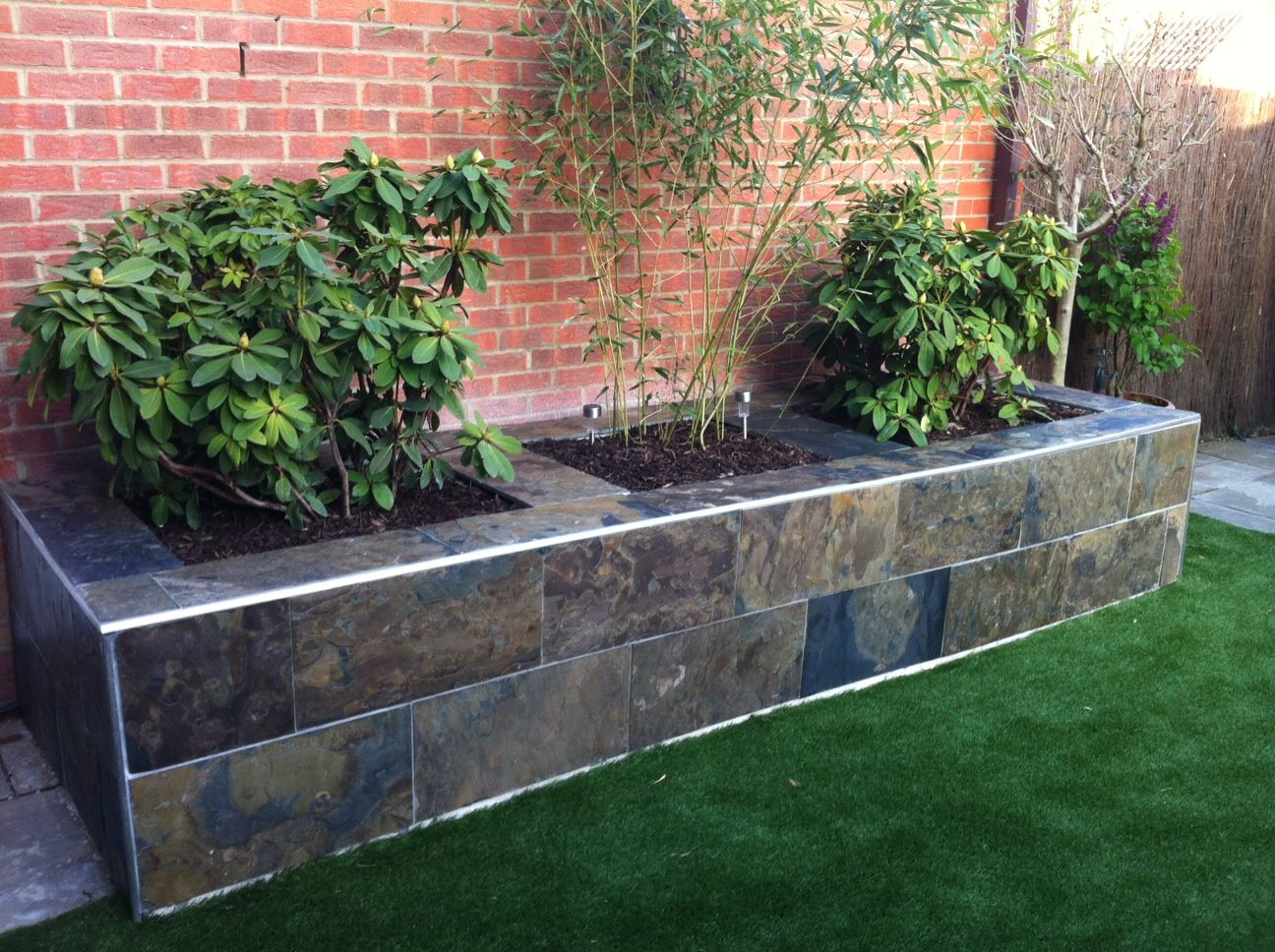 Create A Stunning Raised Flower Bed In Your Garden With Natural Tiles   A Raised  Flower
