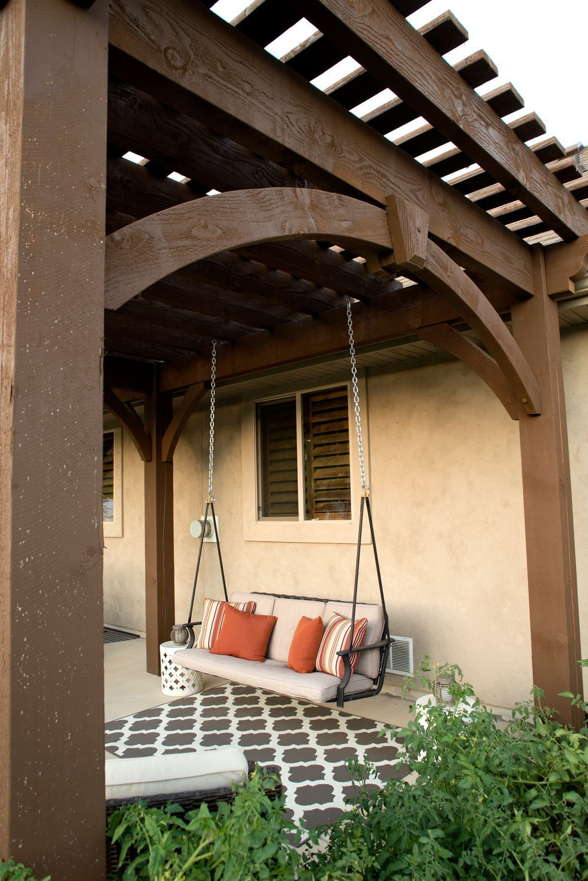Free standing DIY timber frame pergola kit installed over backyard deck  with full arched knee braces and decorative keystones. With old world  craftsmanship ... - Free Standing DIY Timber Frame Pergola Kit Installed Over Backyard
