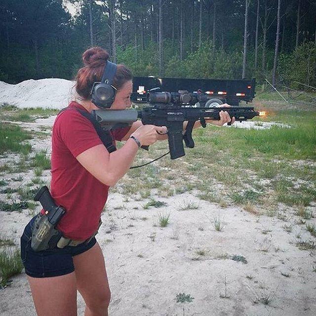 girls shooting guns