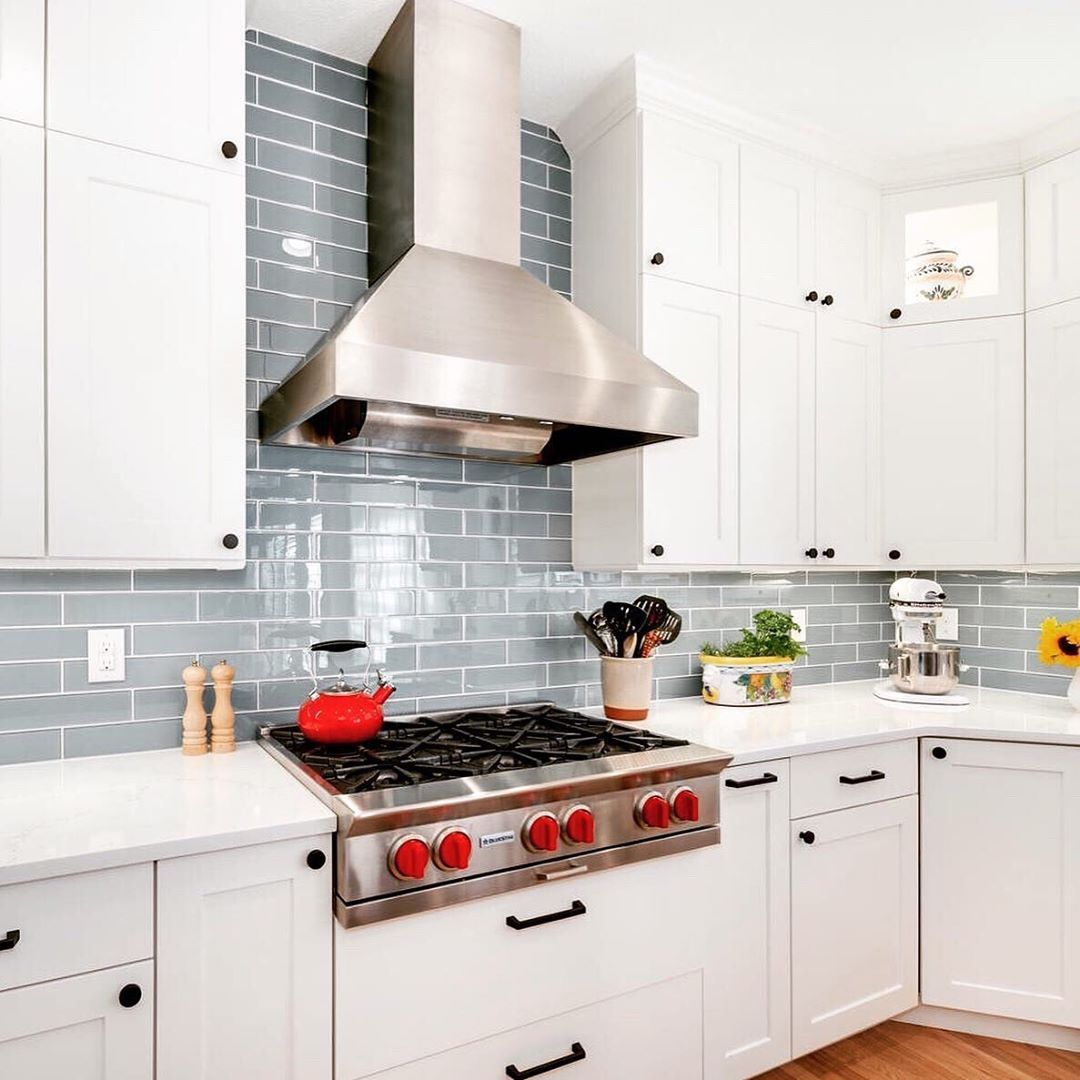 Check Out This Gorgeous Kitchen Backsplash By Hawk Construction Inc The Glossy Blue Finish And Wh New Kitchen Cabinets Kitchen Inspirations Blue Kitchen Walls