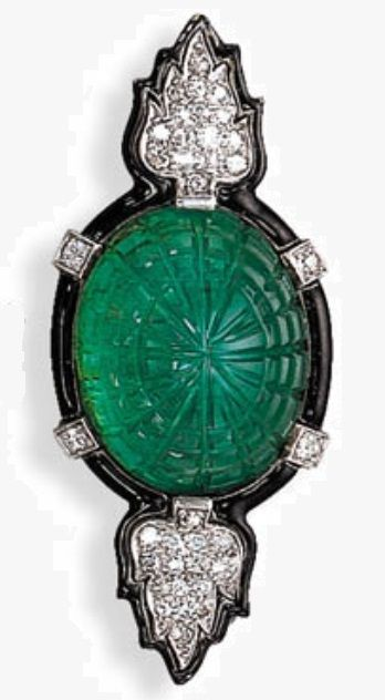 A FINE ART DECO EMERALD, DIAMOND AND ENAMEL BROOCH, BY CARTIER. Set with a central carved cabochon emerald to the pavé-set diamond stylised palmette terminals within a black enamel frame enhanced by collet diamonds, circa 1925, signed Cartier. #Cartier #ArtDeco #brooch