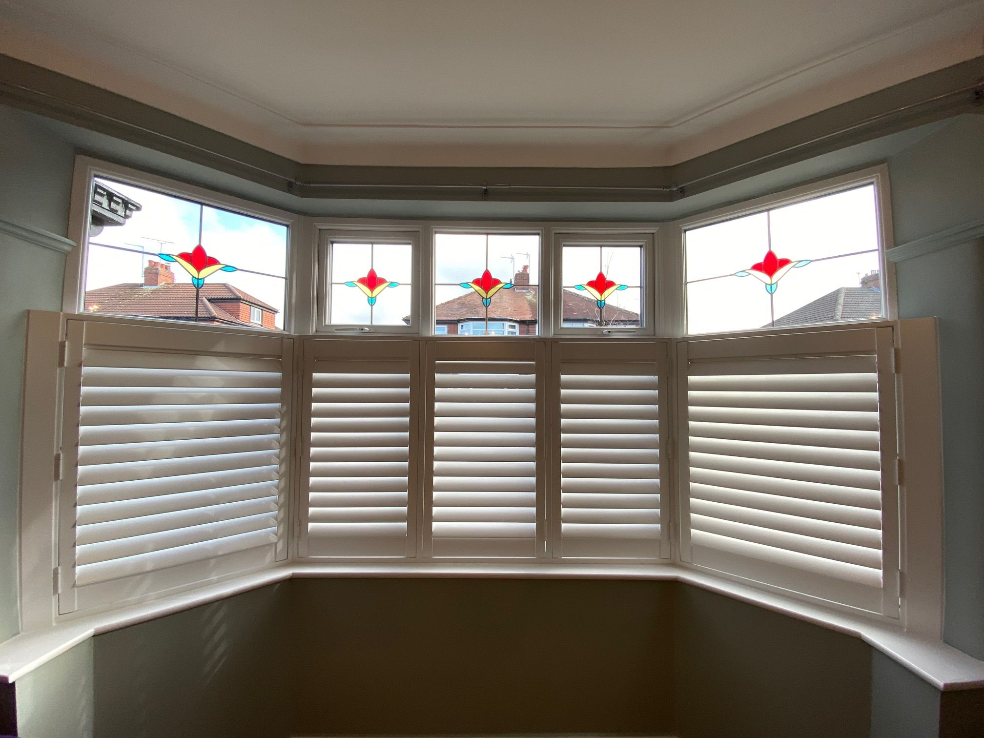 A bay window fitted with café style shutters in Urmston