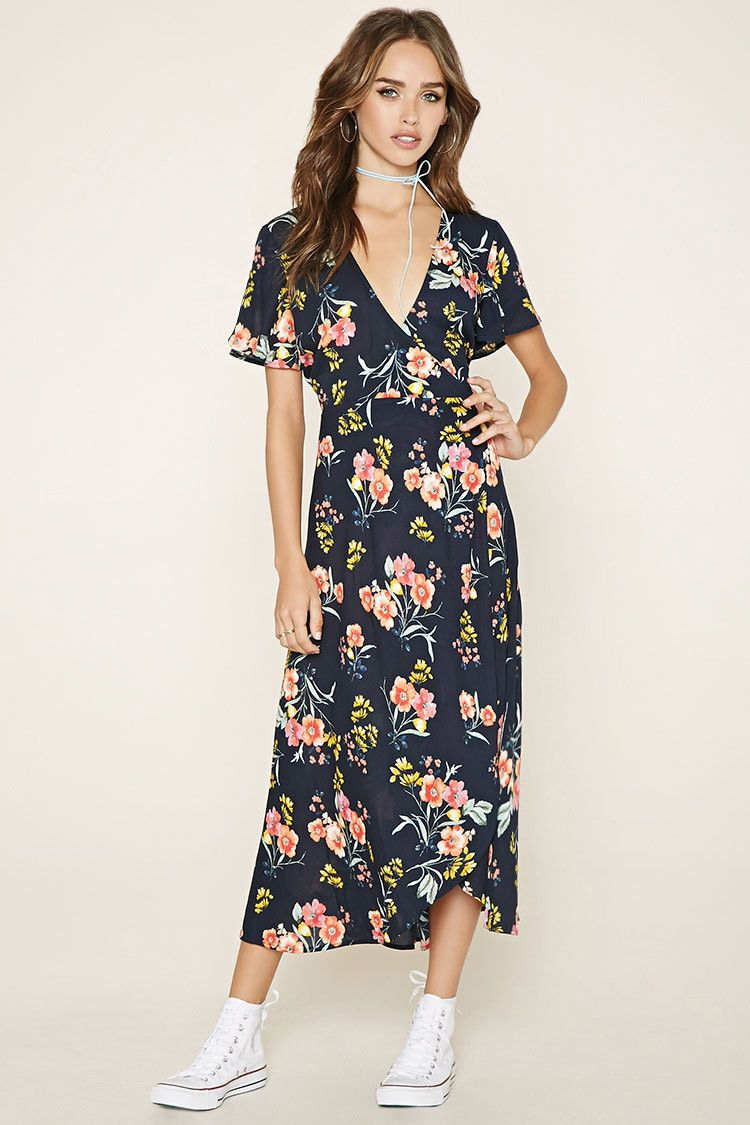 992fd0f31c A woven wrap dress featuring an allover floral print with a self-tie waist,  a plunging V-neckline, and short sleeves.