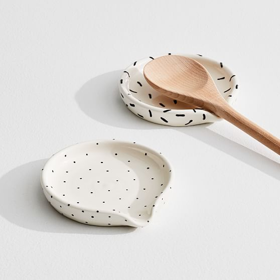 Each piece in Louisa Podlich's collection starts as a tiny ball of clay and is shaped and decorated by hand, a mano. Perfect for meal prepping or Sunday dinner, this A MANO Patterned Spoon Rest is available in two eclectic patterns, and makes cooking (and cleaning) that much easier. Created by A MANO. Learn more 4.75