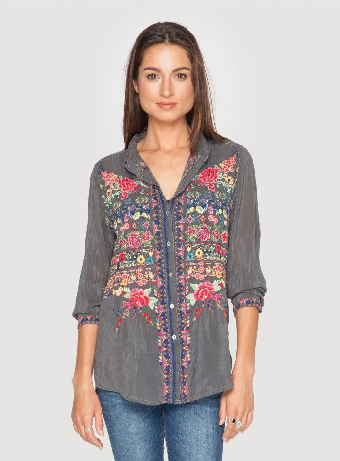 Talin Blouse Choose our Talin Blouse for a signature Johnny Was look! This embroidered button-down blouse is adorned by intricate floral and geometric embroidery designs. Try the Talin Blouse unbuttoned over a silk camisole and your favorite pair of jeans for a one-of-a-kind bohemian casual look! - Rayon - Full Button Closure and Traditional Collar - Signature Embroidery - Machine Wash Cold, Tumble Dry Low
