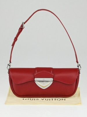 36f6b3bbb84e This Louis Vuitton Rubis Epi Leather Montaigne Clutch Bag is one exquisite  piece. Its chunky shiny hardware and beautiful textured leather makes it ...