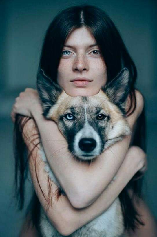 Heterochromia. A girl and her dog, clearly made for each other.