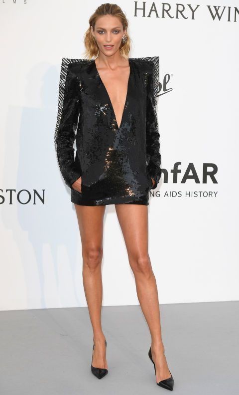 Anja Rubik wore a sequin Saint Laurent dress with exaggerated shoulder pads and a deep V-neck.