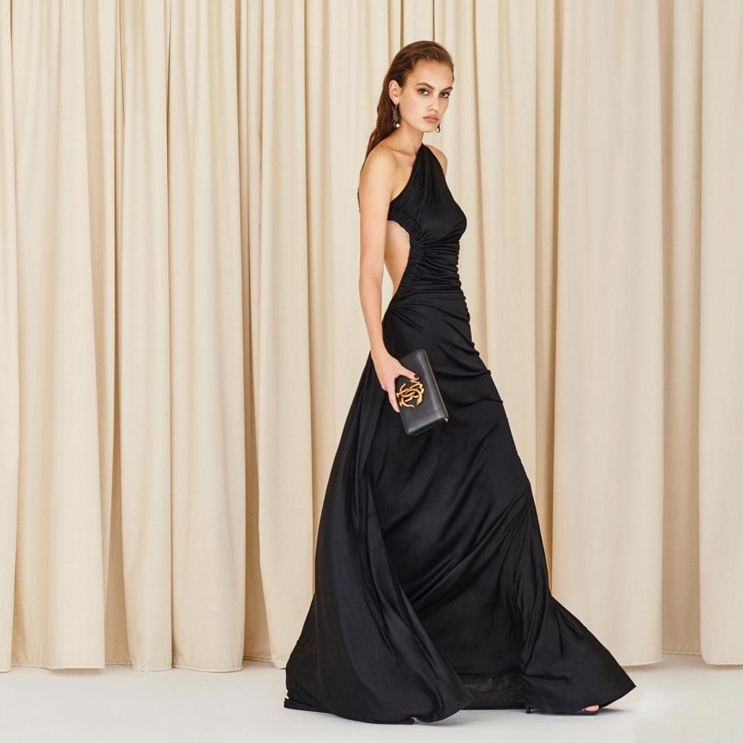 33a116f8866 Utterly feminine and seductive - This black one shoulder evening dress is  sensually and softly draped to accentuate the figure.