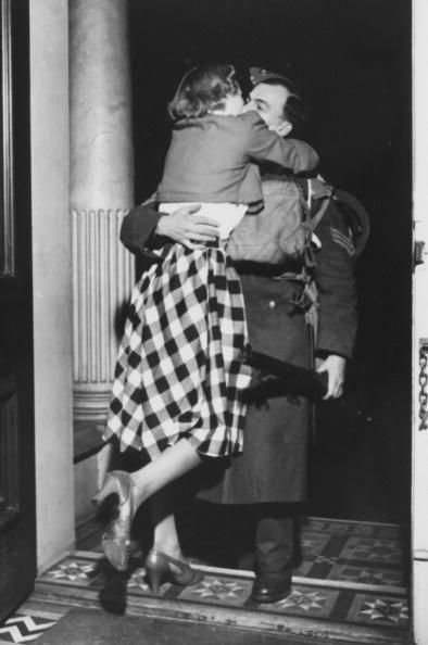 War and Conflict, World War Two, pic: 1945, Homecomings / Britain, A British soldier returning home gets a warm welcome from his wife (Photo by Popperfoto/Getty Images)