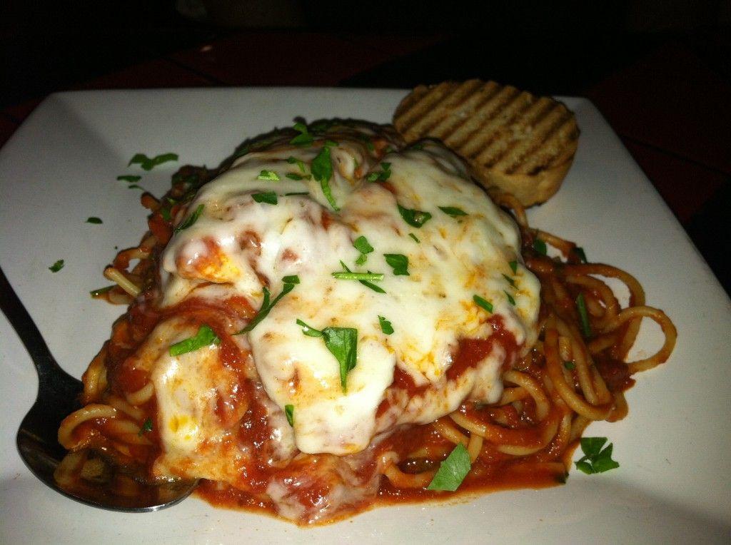 Bakes Chicken Parmesan Over Spaghetti Over Spaghetti Marinara at Vitello's Express