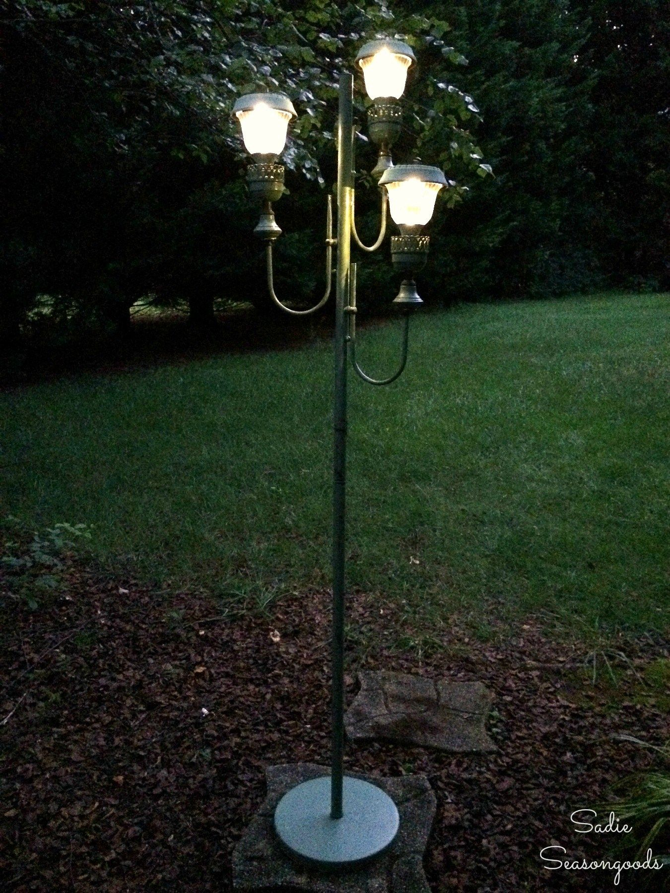 Backyard Decor with an Antique Floor Lamp and Small Solar