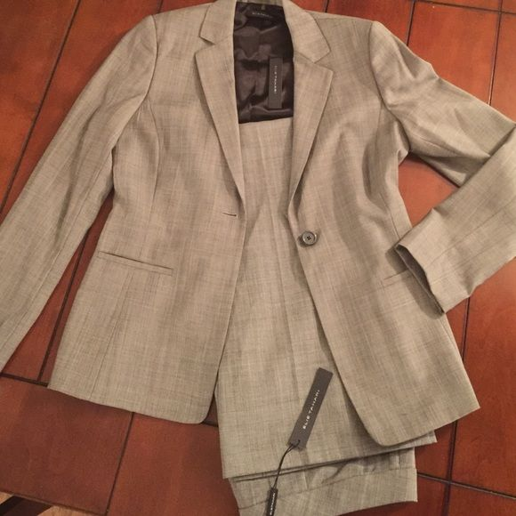 Ellie Tahari 2 pc suit Brand new pantsuit by Elie Tahari. Pants size 12, jacket size 10. 100% wool(polyester lining) Tahari Jackets & Coats Blazers
