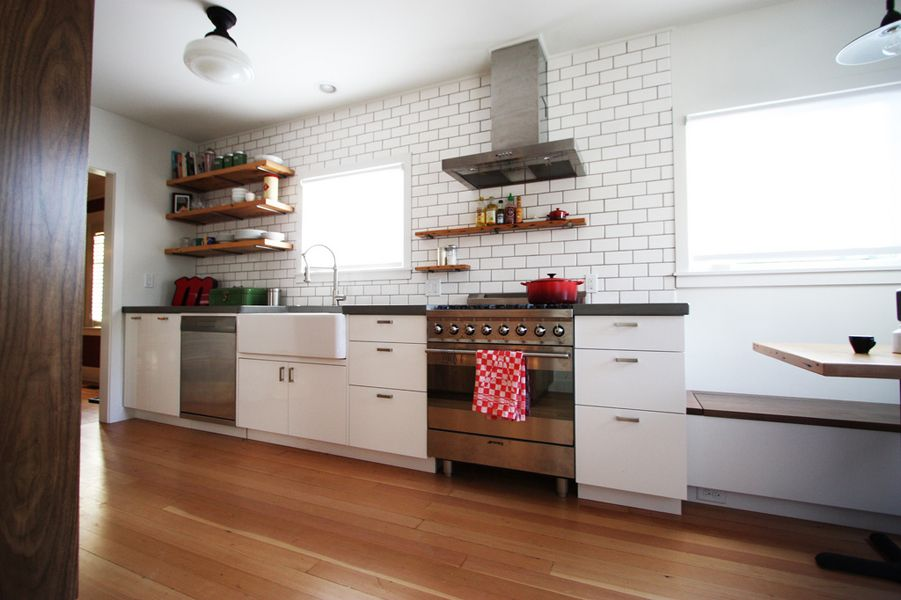 Modern Subway Tile black and white bungalow kitchen with subway tile and wood floors