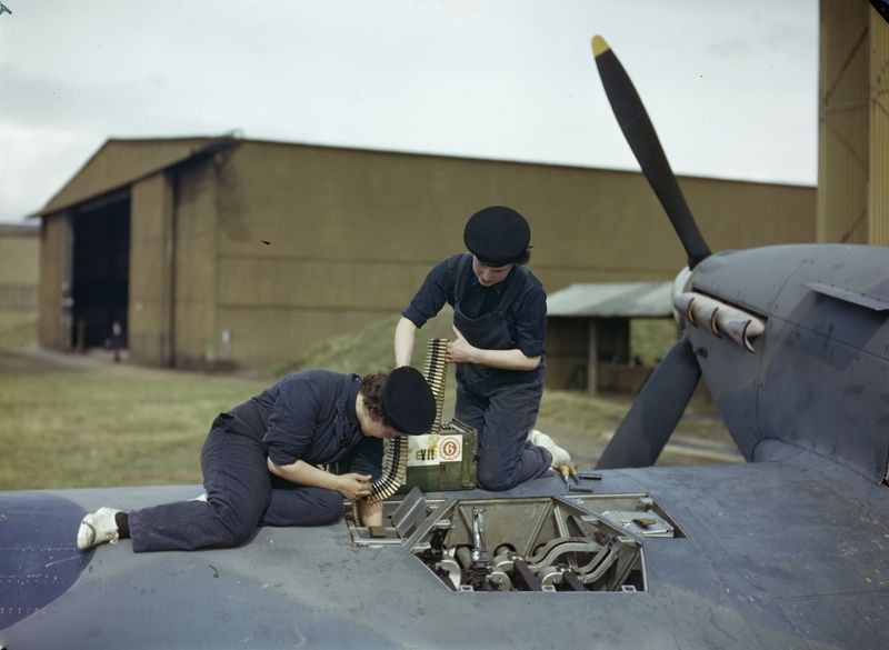 Armourers of the Women's Royal Naval Service (WRNS) re-arm a Hawker Hurricane aircraft at the Fleet Air Arm airfield at Yeovilton, Somerset, 2 September 1943.